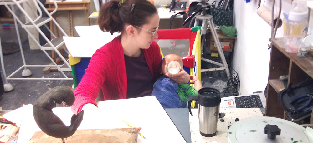 In the Pangolin Studio feeding a 6 month old and doing research and drawing.